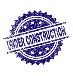 Scratched textured under construction stamp seal vector