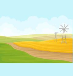 Windmill in field on vector