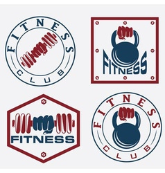 hand holding barbell and kettlebell in emblems of vector image