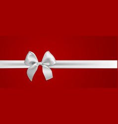 realistic white bow and ribbon isolated on red vector image