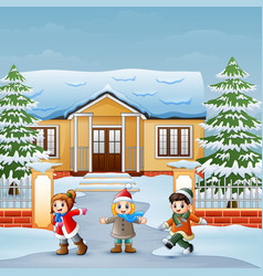 happy kids playing in front of the snowing house vector image