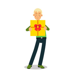 Young smiling blonde man standing with yellow gift vector