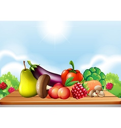 Fresh vegetables and fruits on the table vector image