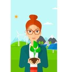 Woman holding plant vector