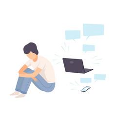 Depressed teen boy sitting on floor with laptop vector