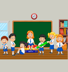Group of elementary school kids in the class room vector