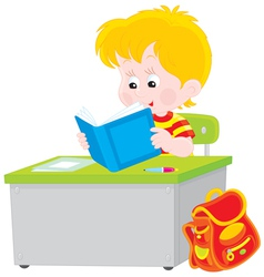 schoolboy reading a textbook vector image vector image