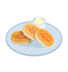 Tasty pancakes oladyi or syrniki lying on plate vector