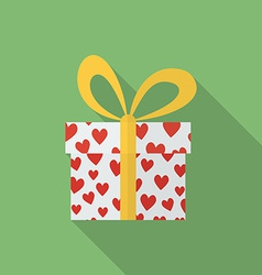 Gift box with hearts and a bow Flat style icon vector image