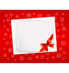 Christmas sheet of paper and red ribbon gift vector image