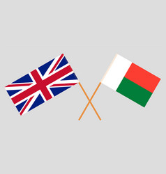 Crossed flags madagascar and uk vector