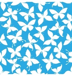 Seamless white flying butterflies pattern vector