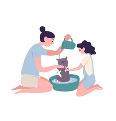 Happy mother and daughter washing cat at home vector