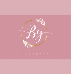 B y letters logo design with golden circle vector