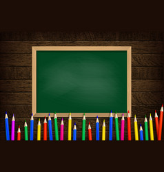 colored pencils on school board background vector image