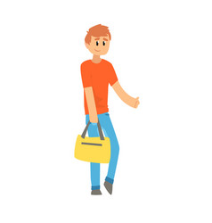 young man with bag standing with a sign vector image