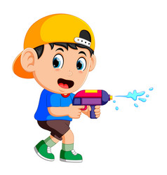 Boy playing with water gun vector
