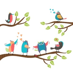 Set of colorful cartoon birds on branches vector