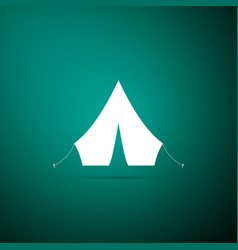 tourist tent icon isolated on green background vector image