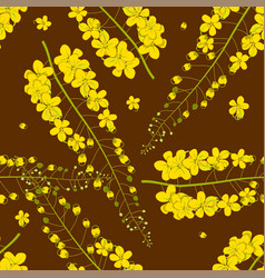 cassia fistula - golden shower flower on brown vector image