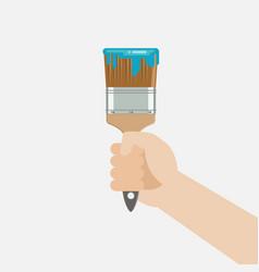 Hand holding paint brush vector