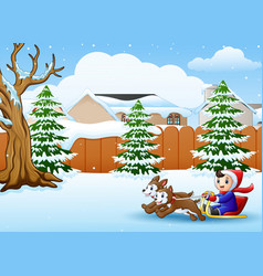cartoon boy riding sled on the snowing village pul vector image