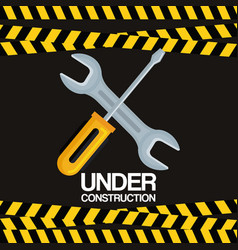 Under construction screwdriver and wrench tools vector