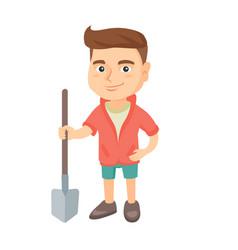 caucasian smiling boy holding a shovel vector image