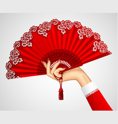 Female hand with open vintage red fan isolated on vector