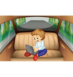 Little boy using computer in the car vector