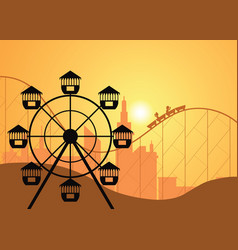 Silhouettes of a city and amusement park with the vector