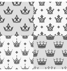 Set of four seamless patterns with crowns vector