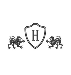 heraldic lions and monogram on shield isolated on vector image