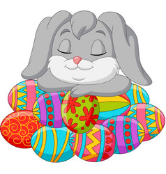 cute rabbit cartoon sleeping on easter eggs vector image
