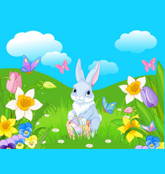 easter bunny with a basket full easter eggs vector image
