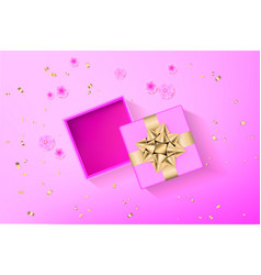 pink gift box with glittering golden bow vector image