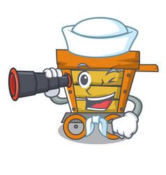 Sailor with binocular wooden trolley mascot vector