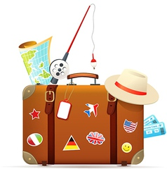 Old travel suitcase with traveling accessories vector image vector image