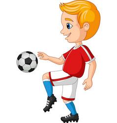 cartoon little boy playing soccer vector image