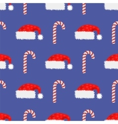 Red hat and candy cane seamless pattern vector