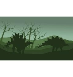 Silhouette of stegosaurus in hills vector image vector image