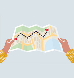 Hands holding paper map vector