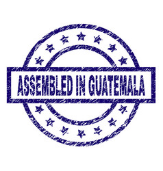 grunge textured assembled in guatemala stamp seal vector image