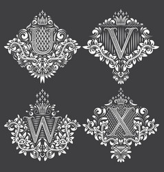 set of heraldic monograms in coats of arms form vector image