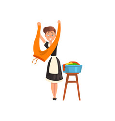 Smiling maid hanging clean wet clothes out to dry vector
