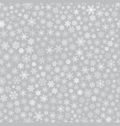 Seamless pattern of snowflakes white on gray vector