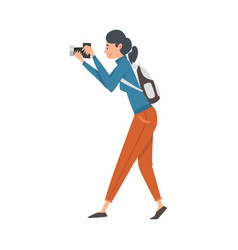Cheerful tourist woman taking photography on vector