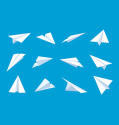 paper plane flying planes in blue sky white vector image