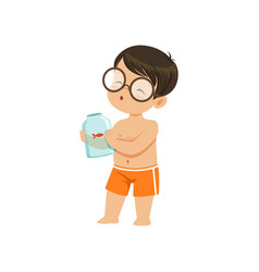 Cute little boy holding glass jar with goldfish vector