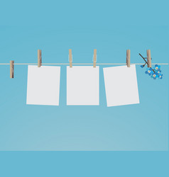 blank photo frames set hanging on clothespins vector image